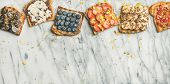 Healthy Breakfast Or Snack. Flat-lay Of Vegan Whole Grain Toasts With Fruit, Seeds, Nuts And Peanut  poster