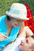 stock photo of titillation  - a portrait of attractive couple in summer environment - JPG