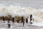 Erosion. Metal Groyne Posts Being Eroded And Damaged By Constant Strong Wave Action poster