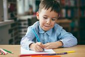 Cute  Smiling Boy Doing Homework,  Coloring Pages, Writing And Painting . Children Paint. Kids Draw. poster