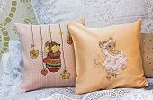 Baby Pillows With Embroidered Mice. Decorative Pillows In A Childrens Room. poster