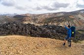 Hiker With Backpack In The Landmannalaugar Valley. Iceland. Colorful Mountains On The Laugavegur Hik poster