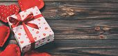 Valentine Or Other Holiday Handmade Present In Paper With Red Hearts And Gifts Box In Holiday Wrappe poster