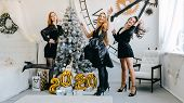 New Year Eve 2020 Party Celebration. Beautiful Women Celebrating New Year 2020. Three Happy Girls In poster