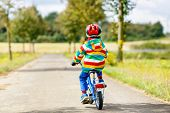 Little Cute Kid Boy On Bicycle On Summer Or Autmn Day. Healthy Happy Child Having Fun With Cycling O poster