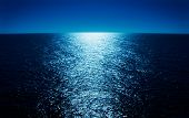 stock photo of cruise ship  - Moonlight Reflecting Across the Ocean  - JPG