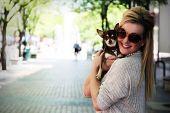 stock photo of chiwawa  - Woman with Chihuahua - JPG