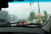 Driving Car In The Rain On Wet Road. Rainy Weather Through The Car Window. Rain Through Wind-screen  poster