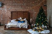 Stylish Christmas Interior, Bedroom With A Lot Of Lights. Comfort Home In A Loft Style With A Decora poster