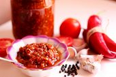 Hot Chilli Pepper Tomato Sauce Paste With Garlic In Bowl Closeup. Adjika, Hot Harissa Sauce - Spicy  poster