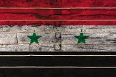 National Flag  Of Syria On A Wooden Wall Background. The Concept Of National Pride And A Symbol Of T poster