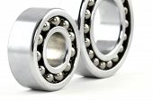 stock photo of ball bearing  - Macro shot of two silver ball bearings.