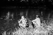 Fly Fish Hobby Of Men. Retirement Fishery. Happy Fishermen Friendship. Two Male Friends Fishing Toge poster