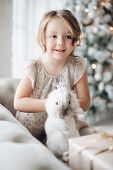 Adorable Girl With Bunny In Hands. Adorable Young Girl Smiling Away In Close-up. poster