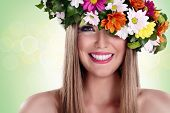 stock photo of fanny  - Young beautiful woman with flower wreath and great smile - JPG