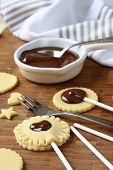 stock photo of shortbread  - Homemade shortbread cookies pops with chocolate process of baking step 3