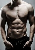 stock photo of shirtless  - Young sexy muscular man posing - JPG