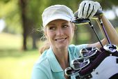 stock photo of silver-hair  - Woman on golf course - JPG