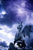 foto of dragon  - a statue of dragon over stormy magic sky - JPG