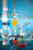 picture of chemical reaction  - glass laboratory apparatus with color liquid samples - JPG