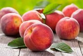 foto of peach  - still life with  fresh peaches on wooden table - JPG