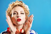 picture of 50th  - Lovely woman retro portrait on blue background - JPG