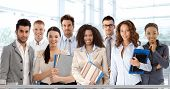 stock photo of work crew  - Team portrait of young and successful business people looking at camera - JPG