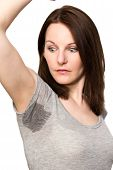 stock photo of wet t-shirt  - Brunette Woman sweating very badly under armpit - JPG