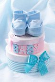 stock photo of booty  - Little baby booties and gift boxes - JPG