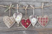 pic of edelweiss  - Hearts over a wooden background - JPG
