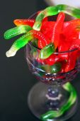 stock photo of nightcrawler  - Red & Green gummy worms are taking over!