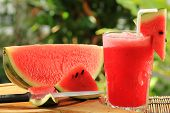 stock photo of melon  - Fresh watermelon smoothie served in the garden - JPG