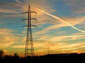 stock photo of electricity pylon  - Electricity pylons with sunset - JPG