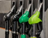 stock photo of gasoline station  - Fuel pistols at petrol station - JPG