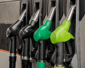 foto of petrol  - Fuel pistols at petrol station - JPG