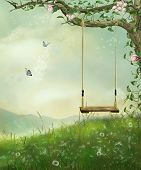 foto of fantastic  - view of a swing hanging off a tree on a fantastic hill with mountains in the back - JPG