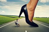 stock photo of big-foot  - angry woman screaming at big lady boss on the road - JPG