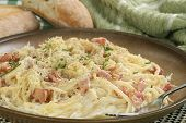 foto of carbonara  - spaghetti carbonara with sauce and chopped bacon - JPG