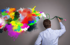 foto of draft  - Businessman painting abstract colorful design on gray background concept for  business creativity - JPG
