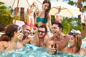 image of alcoholic drinks  - Group Of Friends Having Party In Pool Drinking Champagne - JPG