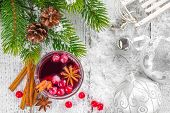 stock photo of cinnamon  - Mulled wine with cinnamon and anise stars - JPG