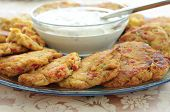 stock photo of crab-cakes  - Fresh Maryland Crab Cakes on a Platter with Sauce - JPG