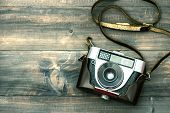 foto of toned  - Vintage camera on wooden background - JPG