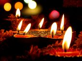 pic of diwali lamp  - Beautiful lamps surrounded with flowers for a traditional ritual during Diwali festival