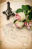 stock photo of nostalgic  - roses antique french postcards and souvenir Eiffel Tower from Paris - JPG