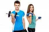 foto of lifting weight  - Two teenagers boy and girl doing fitness workout with weights isolated on white background - JPG