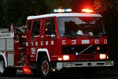 stock photo of fire brigade  - Fire truck with it - JPG