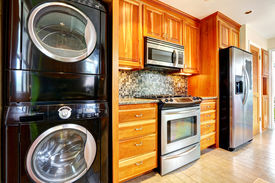 picture of combinations  - Kitchen maple storage combination with steel kitchen appliances and black laundry appliances - JPG