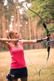 foto of longbow  - Selective focus on the lovely young fair - JPG