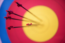 image of longbow  - Selective focus on the pink arrows hitting the mark - JPG